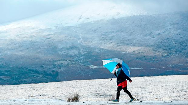 A woman walking in the snow near Killakee in the Dublin Mountains. Picture: PA