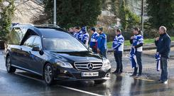 The hearse carrying the remains of Mr Scott. Photo: Damien Eagers
