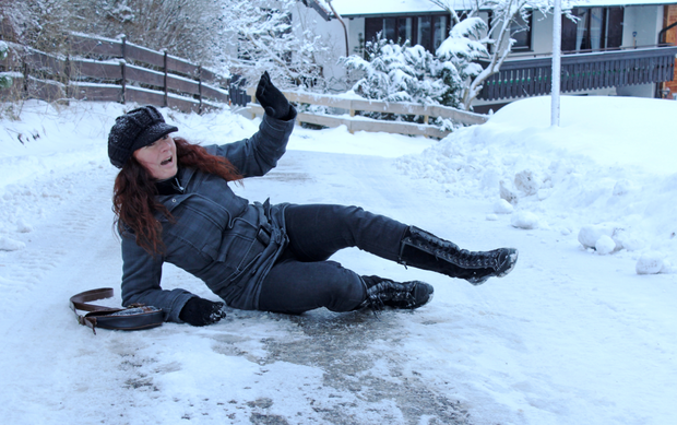 Approach every surface with caution and assume that all dark, wet areas on pavements are icy and slippery. Stock photo