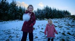 Shan Smith, and her sister Lily, Firhouse, enjoying the snowfall at Glencree in the Dublin Mountains. Picture: Arthur Carron