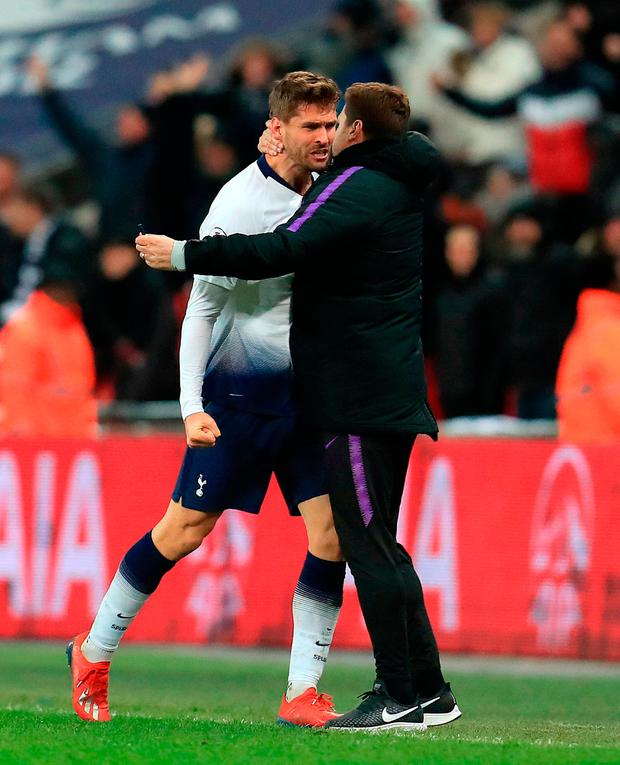 Tottenham Hotspur's Fernando Llorente celebrates scoring his side's winner with manager Mauricio Pochettino during the Premier League match at Wembley Stadium, London. Mike Egerton/PA Wire