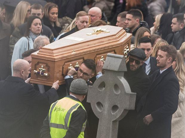 The coffin is carried to the graveyard after the funeral of Zach Parker at St. Colmcille's Church, Swords. Picture: INM