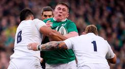 White wall: Tadhg Furlong is tackled by England duo Billy Vunipola, left, and Joe Marler during their last visit to Six Nations. Photo: Sam Barnes/Sportsfile
