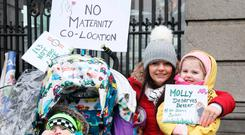 Protest: Melanie and Isabelle Byrne (4) from Co Kildare join protesters at Leinster House yesterday. Photo: Collins