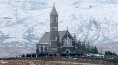 The funeral Mass of Mícheál Roarty in the Sacred Heart Church, Dunlewey, Co Donegal in the snowy shadow of Mount Errigal. Photo: Mark Condren