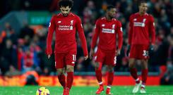 Mohamed Salah of Liverpool looks dejected after Leicester City's equaliser on Wednesday night