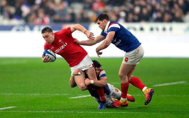 Wales' Josh Adams is tackled by France's Wesley Fofana (centre) and Damian Penaud. Photo: David Davies/PA Wire