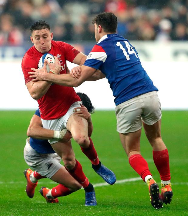 Wales' Josh Adams is tackled by France's Wesley Fofana (left) and Damian Penaud. Photo: David Davies/PA Wire