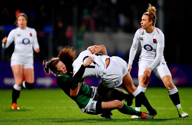 Tatyana Heard of England is tackled by Lauren Delany of Ireland. Photo by Ramsey Cardy/Sportsfile
