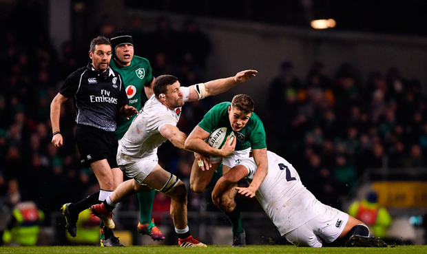 Garry Ringrose of Ireland is tackled by Mark Wilson, left, and Jamie George of England