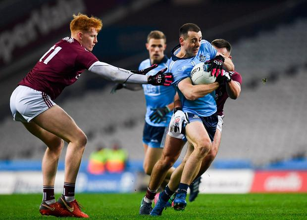 Cormac Costello of Dublin in action against Peter Cooke and Cillian McDaid, behind, of Galway. Photo: Harry Murphy/Sportsfile