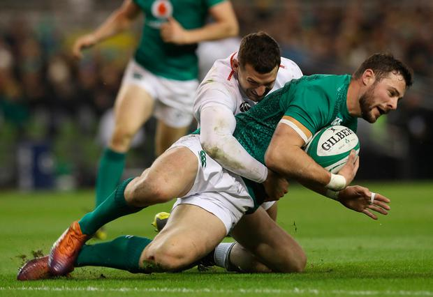 England's Jonny May grapples with Ireland's Robbie Henshaw. Photo: PA