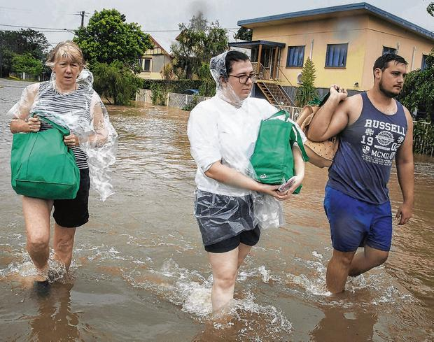Damp: Residents evacuate to higher ground in Townsville, Queensland. Photo: Andrew Rankin/AAP