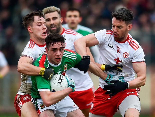 Mayo's Ciaran Treacy comes under pressure from Kieran McGeary, Tiernan McCann and Mattie Donnelly of Tyrone. Photo: Oliver McVeigh/Sportsfile