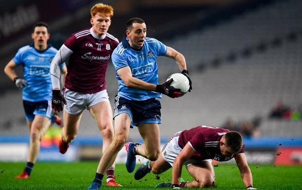 Dublin's Cormac Costello breaks away from Peter Cooke, left, and Cillian McDaid of Galway. Photo: Harry Murphy/Sportsfile
