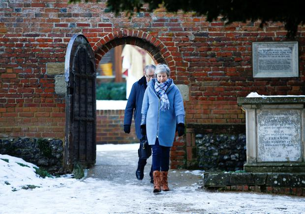 'New ideas': British Prime Minister Theresa May and her husband Philip leave church near Maidenhead, England, yesterday. Photo: Reuters/Henry Nicholls