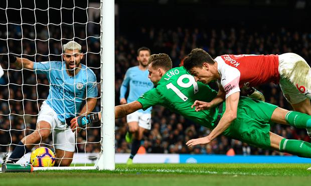 Sergio Aguero completes his hat-trick despite the efforts of Arsenal goalkeeper Bernd Leno and Laurent Koscielny. Photo: Stu Forster/Getty Images