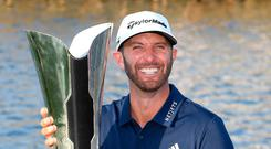 Dustin Johnson celebrates with the trophy after his Saudi International victory Photo: Getty Images