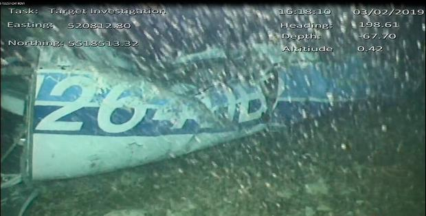 Still from handout video issued by the Air Accidents Investigation Branch showing the rear left side of the fuselage, including part of the aircraft registration, in the wreckage of the plane which was carrying Cardiff City footballer Emiliano Sala, after it was discovered in the English Channel. AAIB/PA Wire