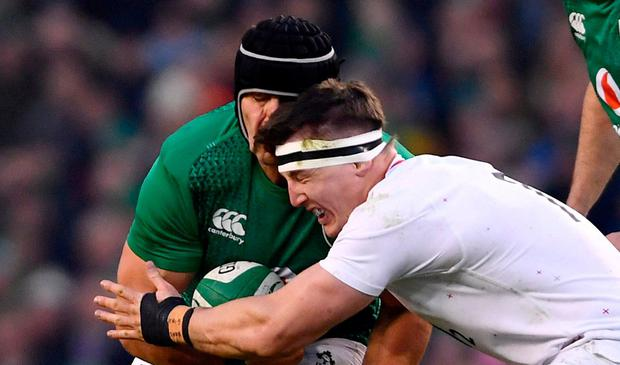 CJ Stander of Ireland is tackled by Tom Curry of England during the Guinness Six Nations Rugby Championship match between Ireland and England in the Aviva Stadium in Dublin. Photo by Ramsey Cardy/Sportsfile