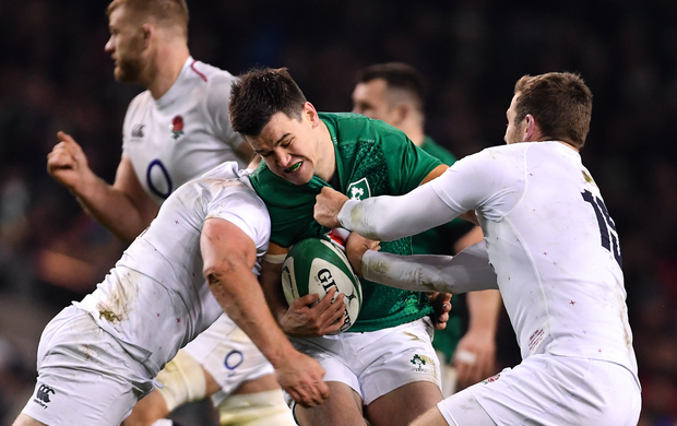 2 February 2019; Jonathan Sexton of Ireland is tackled by Owen Farrell, left, and Elliot Daly of England during the Guinness Six Nations Rugby Championship match between Ireland and England in the Aviva Stadium in Dublin. Photo by Ramsey Cardy/Sportsfile