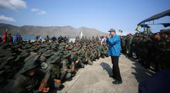 Tough talking: Nicolas Maduro addresses soldiers during exercises. Photo: Miraflores Palace/Handout via Reuters