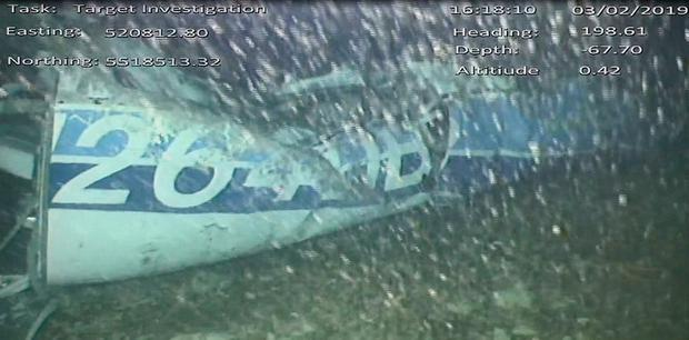 Wreckage: Footage shows the rear left side of the fuselage of the Piper Malibu aircraft. Photo: AFP Photo/AAIB/Getty Images