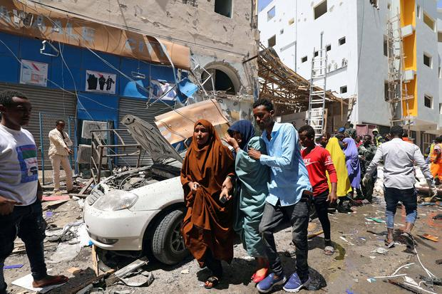 Civilians evacuate from the scene where a car bomb exploded at a shopping mall in Mogadishu, Somalia. Photo: Reuters/Feisal Omar