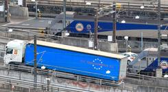 Departing: A lorry leaves the Eurotunnel in Folkestone, Kent. Photo credit: Gareth Fuller/PA Wire