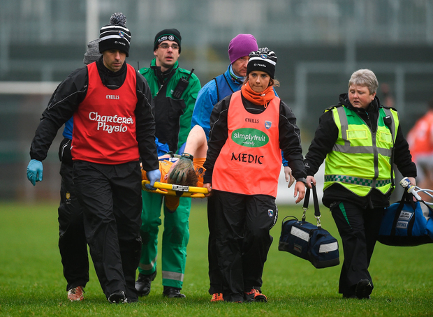 Dermot Coughlan of Clare is carried off the pitch after suffering an injury. Photo by Philip Fitzpatrick/Sportsfile