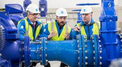 Pipeline: Housing Minister Eoghan Murphy, centre, with Tony Keohane, chairman of Eriva, left, and Eamon Gallen, Irish Water MD, at the Vartry to Callowhill pipeline opening yesterday. Photo: Naoise Culhane