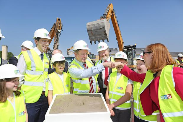 Cornerstone: Then Taoiseach Enda Kenny and Health Minister Simon Harris cast the foundation stone in 2017. Photo: Julien Behal