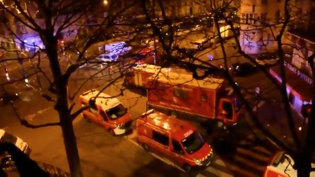 Emergency vehicles line a street where a residential building had caught fire in Paris, France, February 5, 2019, in this still image taken from a social media video. Pierre-Alexandre Vezinet/via REUTERS