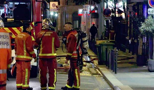 In this image taken from video, firemen and emergency workers set up operations on a side street near the site of a fire in an apartment building, Tuesday, Feb. 5, 2019, in Paris, France. (AP Photo)