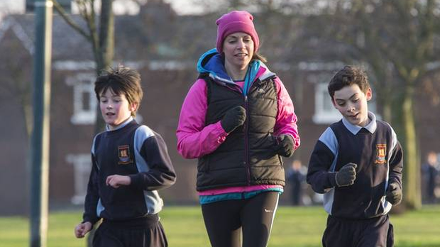 Teacher Carol Howley with her pupils Aaron Graham and Jack Wheelan of St Brendan's Boys National School, Artane pictured during their run. Photo: Colin O'Riordan