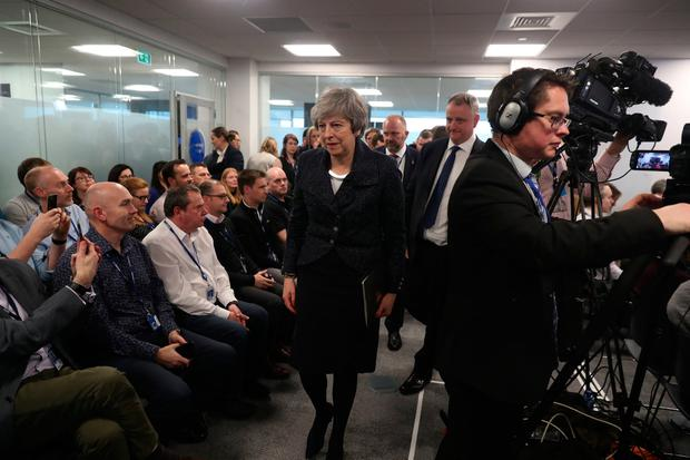 British Prime Minister Theresa May leaves after speaking with business representatives at Allstate in Belfast on her Brexit plans. Photo: Liam McBurney/PA Wire
