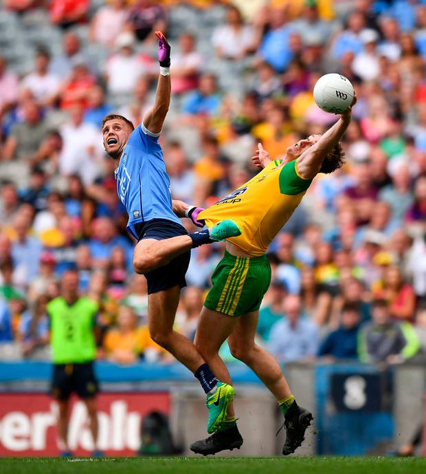 Donegal's Hugh McFadden and Dublin's Jonny Cooper compete for the ball during last year's All-Ireland SFC quarter-final at Croke Park. Donegal want to prevent quarter-final counties from being able to nominate GAA HQ as their home venue. Photo: David Fitzgerald/Sportsfile