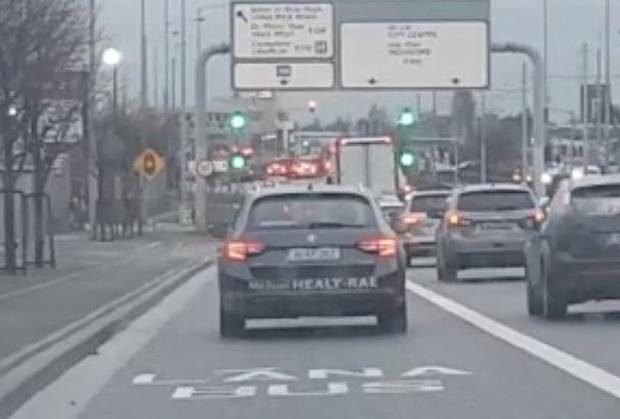 Footage: Michael Healy-Rae drives his car in the bus lane on the M7 yesterday