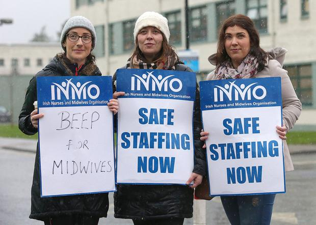Determined: From left, nurses Ciara Byrne, Susan Sherwood and Clare Harte outside St Luke's General Hospital in Kilkenny. Photo: Damien Eagers