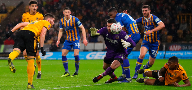 Matt Doherty heads home Wolves' first goal in their 3-2 victory over Shrewsbury Town in the FA Cup fourth replay at Molineux. Photo: Getty Images
