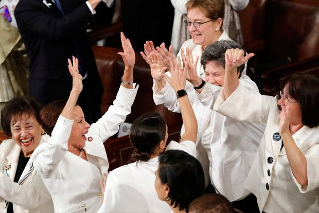Members of Congress cheer after President Donald Trump acknowledges more women in Congress during his State of the Union address to a joint session of Congress on Capitol Hill in Washington, Tuesday, Feb. 5, 2019. (AP Photo/J. Scott Applewhite)