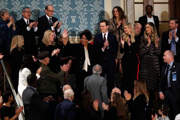 Alice Johnson waves as President Donald Trump acknowledges her during his State of the Union address to a joint session of Congress on Capitol Hill in Washington, Tuesday, Feb. 5, 2019. (AP Photo/J. Scott Applewhite)