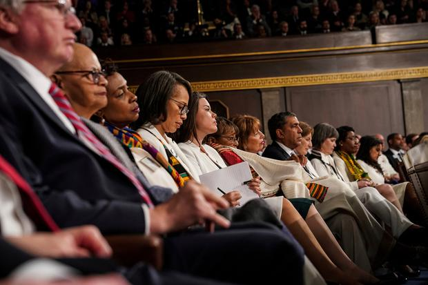 Many Democratic legislators wear white as President Donald Trump gives his State of the Union address to a joint session of Congress, Tuesday, Feb. 5, 2019 at the Capitol in Washington. (Doug Mills/The New York Times via AP, Pool)