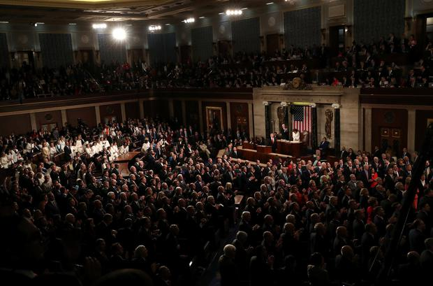 Attendees applaud as U.S. President Donald Trump delivers his second State of the Union address to a joint session of the U.S. Congress in the House Chamber of the U.S. Capitol on Capitol Hill in Washington, U.S. February 5, 2019. REUTERS/Leah Millis