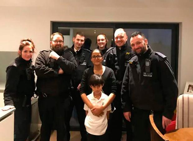 Metropolitan Police handout photo of Noah Gofur, with his mother Marjana, and the officers who responded to his 999 call. The seven-year-old has helped save his mother's life by ringing the police after she collapsed. Metropolitan Police/PA Wire