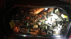 A car boot filled with stolen cigarettes after gardai intercepted the car