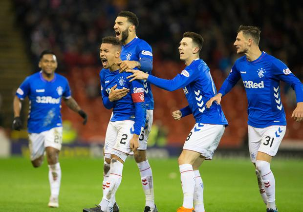 Rangers James Tavernier (second left) celebrates scoring his side's third goal of the game from the penalty spot during the Ladbrokes Scottish Premiership match at Pittodrie Stadium, Aberdeen. Jeff Holmes/PA Wire.