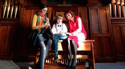 Sweet music: Maria Jose Rojas Cruz plays the oboe for Mylo O'Brien (7) and Culture Minister Josepha Madigan at the launch of the Le Chéile project at the Royal Irish Academy of Music in Dublin. Photo: Niall Carson/PA Wire