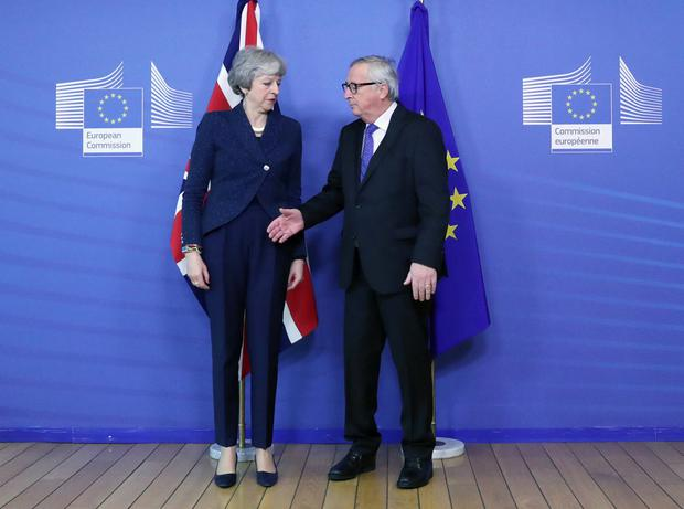 European Commission President Jean-Claude Juncker extends his hand to British Prime Minister Theresa May at the European Commission headquarters in Brussels, Belgium February 7, 2019. REUTERS/Yves Herman