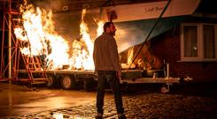 Coronation Street: A crowd gathers round the burning boat